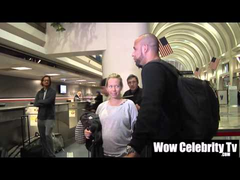 Kendra Wilkinson mobbed by paparazzi as she arrives to LAX Airport