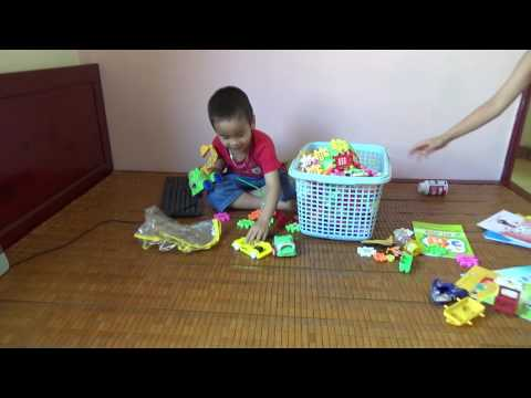 family fun pack Funny junior guy with brother play kids indoor playground. Super family fun Funny