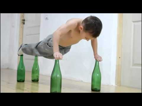 Small Kid  Push-Ups On Glass Bottles