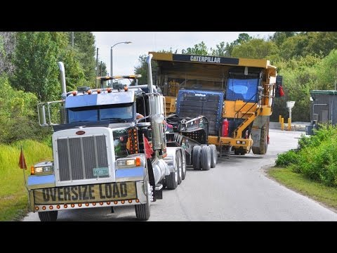 Caterpillar 777 Mining Haul Truck Transported by 11 Axle Lowboy Music Videos