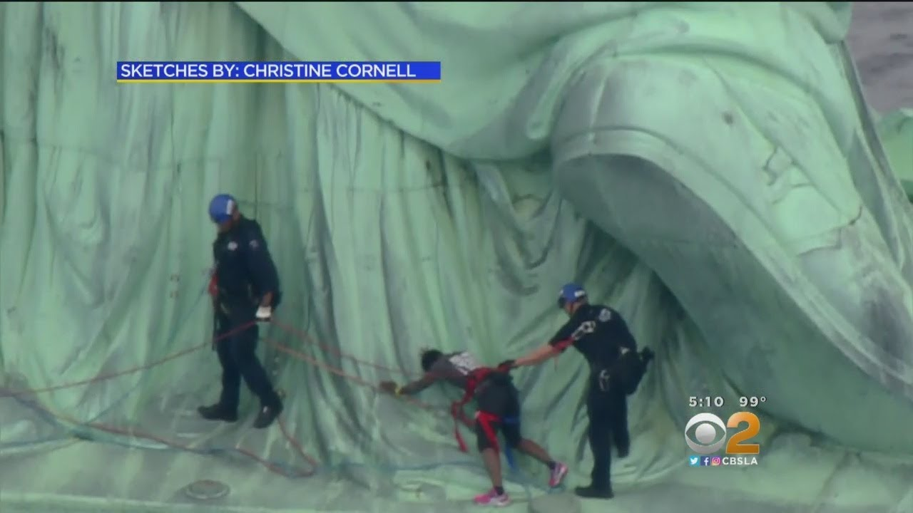 Statue Of Liberty Protester .Explains Why She Climbed