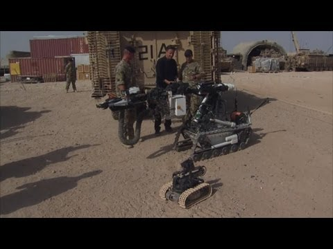 David Cameron takes control of bomb disposal robot at Camp Bastion in Afghanistan