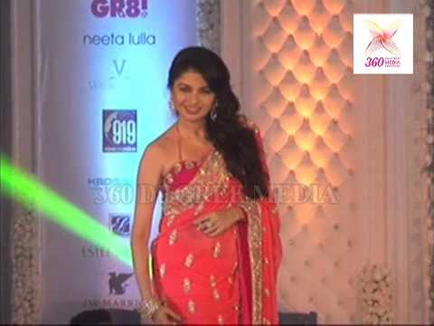 Bollywood actress Bhagyashree in beautiful peach designer embroidery georgette saree