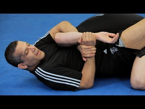 How to Do Jacaré-Style Kimura from Guard | MMA Submissions Image 1