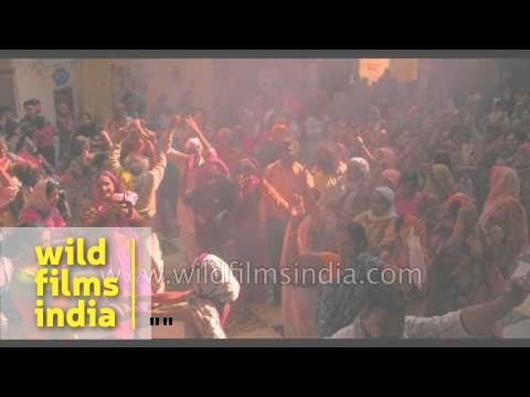 Crowd throw colours on each other on occasion of Holi festival celebration - Vrindavan