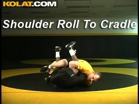 Shoulder Roll to Cradle KOLAT.COM Wrestling Techniques Moves Instruction Image 1