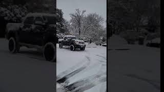 2012 Toyota Tundra lifted in the snow