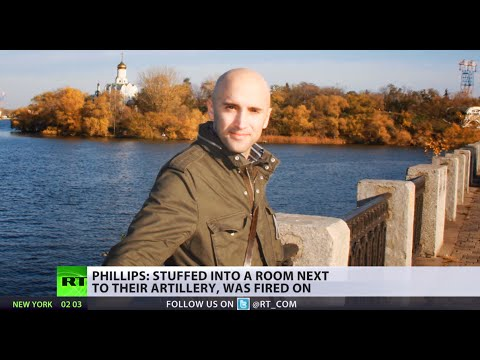 'I was blindfolded and held at gunpoint'- RT stringer on Ukraine captivity