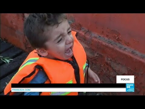 On board an armed smugglers' boat with Iraqi and Syrian refugees