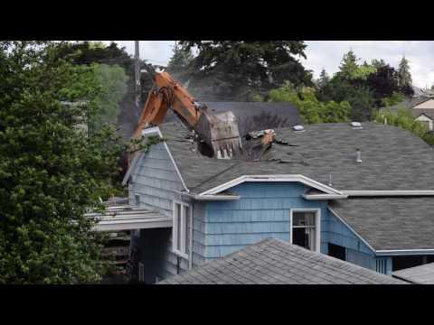 Excavator Demolishes House