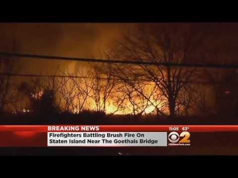 Firefighters Battle Intense Brush Fire On Staten Island