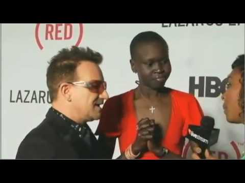 (RED) Bono and Alek Wek on the Red Carpet for The Lazarus Effect