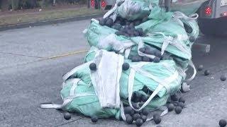 44,000 pounds of metal balls spill, bounce down Seattle street