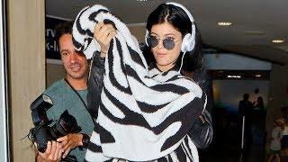 Kylie Jenner Keeps Warm With Her Zebra Blanket [2014]