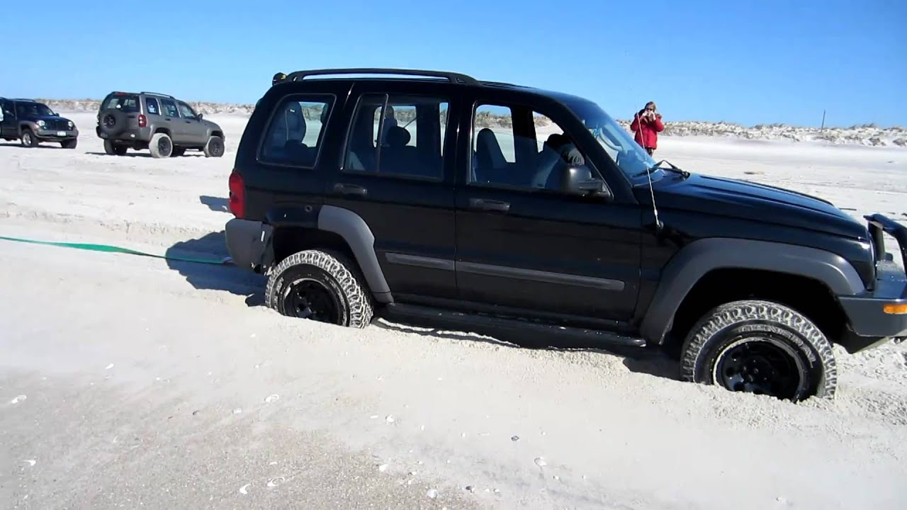 Jeep Liberty Pulls Out A Stuck Range Rover On The Beach