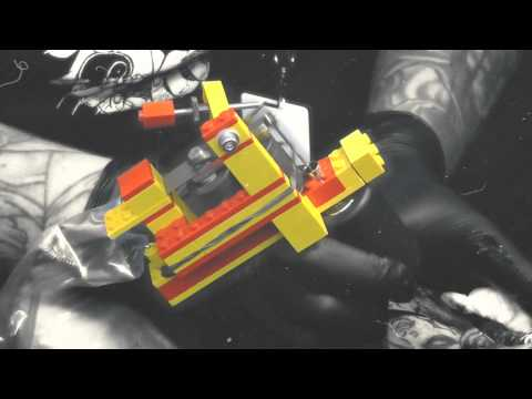 Worlds first working coil tattoo machine with a Lego frame