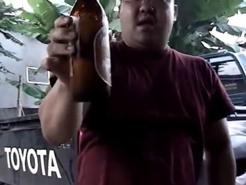 JB Slams A 22.5 oz Bottle Of Beerlao