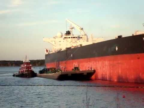 Cargo ship, barge, and tug boat at work