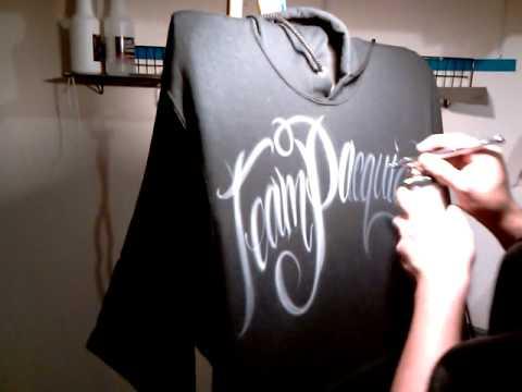 Airbrush lettering on black hoodie