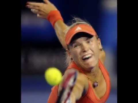 Caroline Wozniacki vs Anastasia Rodionova at Australian Open 2012 First Round - Photos