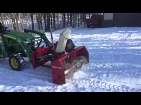 Front mounted snow blower