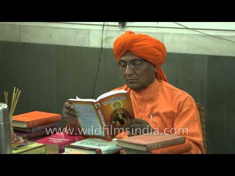 Swami Agnivesh reading Hindu holy books