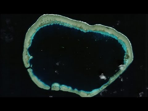 Satellite Images Show China Building Military Island