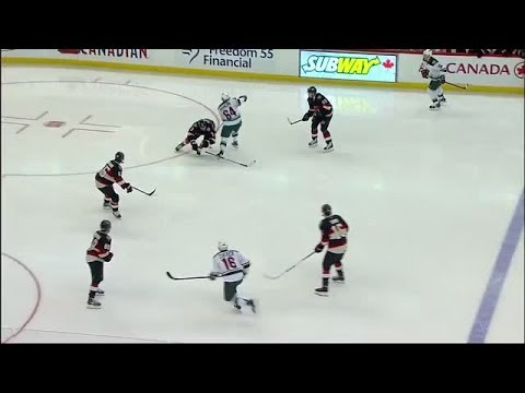 Ottawa Senators defensemen Marc Methot delivers a huge hip-check on Minnesota Wilds forward Mikael Granlund.