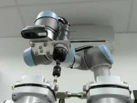 Universal-Robots vision guided system with normal web camera by Zacobria mounting screws (Video 1)