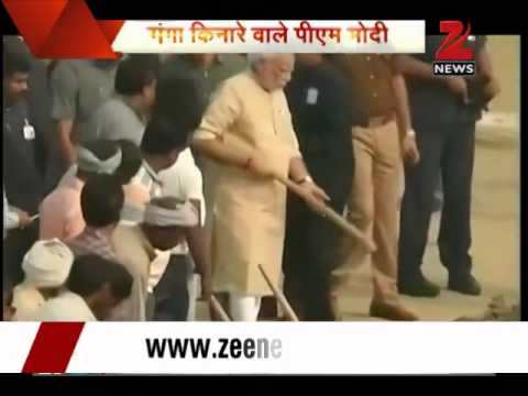 PM Modi cleans Assi Ghat in Varanasi
