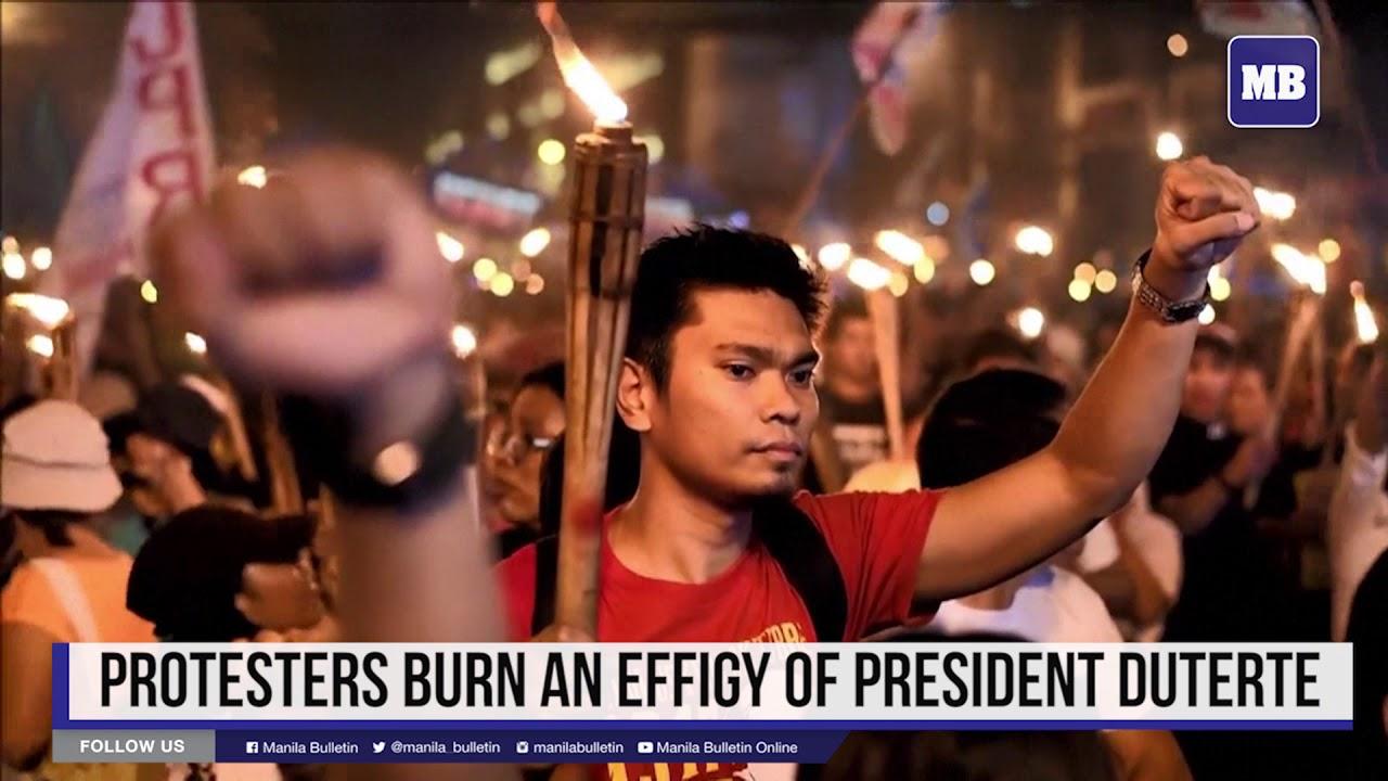 Protesters burn an effigy of President Duterte