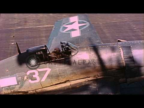 US Navy F6Fs taxi along flight deck of USS Lexington in the Pacific Ocean during ...HD Stock Footage
