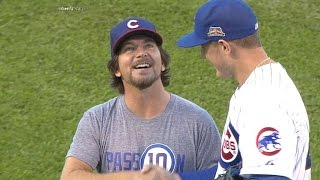 Vedder throws first pitch, visits TV booth