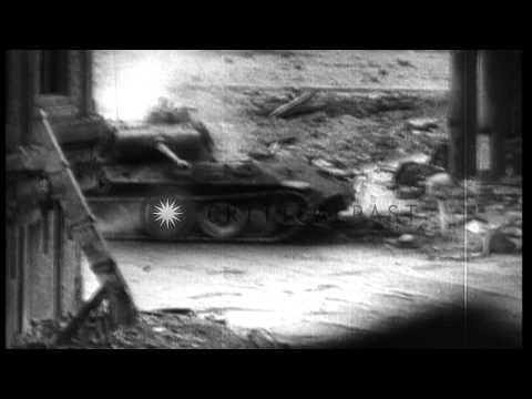 Tanks and troops of US First Army enter Cologne, Germany,during World War II. HD Stock Footage