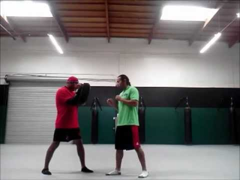 kickboxing 101: spike elbow and front kick Image 1