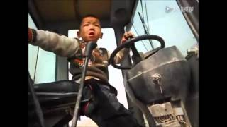 5 Year-old Chinese Boy Operating a Tractor Like a pro!