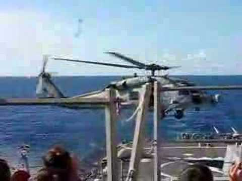 SH-60 takes off from a DDG Video