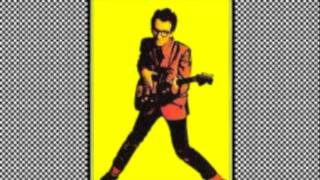 Watch Elvis Costello Poison Moon video