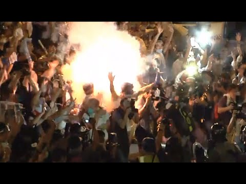 Hong Kong Close-up: Tear gas canister explodes among protesters