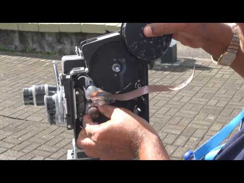 The Pioneer Raj and Surendra Brijmohun loading film on their 16mm professional Movie Camera