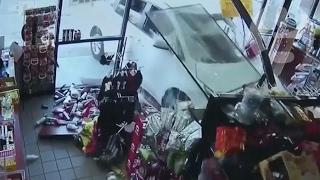 Car smashes into New York shop