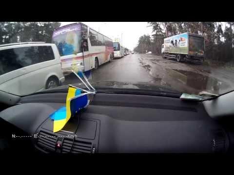 запорожские автобусы с титушками  в Киеве при вьезде на Бориспольский круг в сопровождении ГАИ