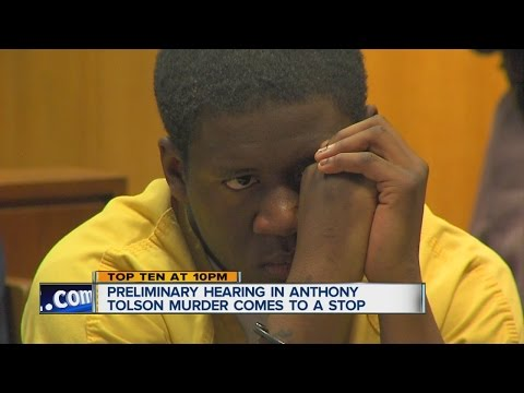 Defendant's mouthing words in court stops trial