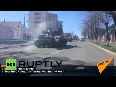 Nagorno-Karabakh: Tanks roll through Stepanakert after fighting erupts