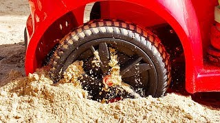 FUNNY BABY Stuck in the sand TOWING Ride on POWER WHEEL QUAD BIKE and Red Car