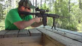 Shooting Bushmaster AR15 Remington .223 ammo with Leupold Mark 4 CQ/T