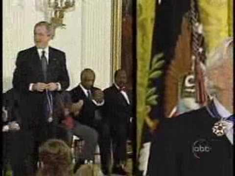 Muhammad Ali gives Bush the crazy sign