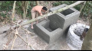 Primitive technology with survival skills build a water filter tank part 2