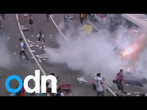 Hong Kong police disperse pro-democracy protests with tear gas