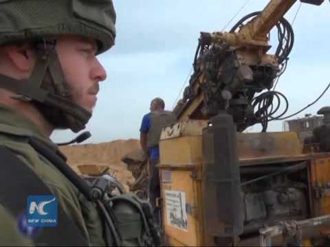 Israel vows armed response to any sign of Hamas aggression